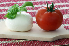 mozzarella with fresh tomato and basil Stock Photos