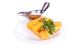 Mozzarella fried with mayonnaise. Cheese Sticks with milk, mayonnaise and parsley on the plate Royalty Free Stock Image