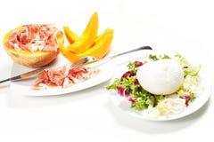 Mozzarella and ham and melon Stock Photos