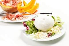 Mozzarella and ham and melon Stock Photography