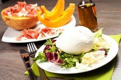 Mozzarella and ham and melon Royalty Free Stock Image