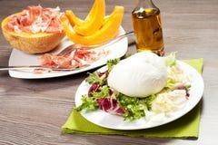 Mozzarella and ham and melon Stock Images