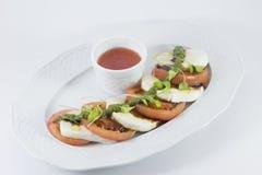 Mozzarella med tomaten Fotografering för Bildbyråer