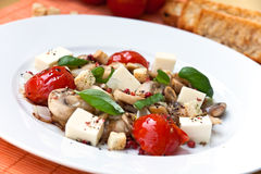 Mozzarella with mushrooms, cherry tomatoes,mint Royalty Free Stock Images