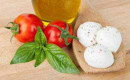 Mozzarella, olive oil, tomatoes and basil Royalty Free Stock Image