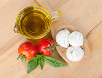 Mozzarella, olive oil, tomatoes and basil Stock Photography
