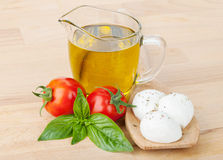 Mozzarella, olive oil, tomatoes and basil Royalty Free Stock Photography