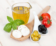 Mozzarella, olives, tomatoes and basil Stock Photos