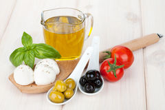 Mozzarella, olives, tomatoes and basil Stock Image
