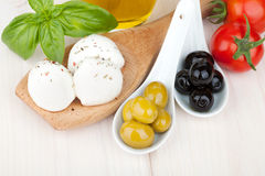 Mozzarella, olives, tomatoes and basil Royalty Free Stock Photos