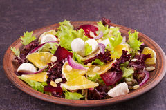 Mozzarella, Orange, Beetroot, Red Onion, Nuts and Seeds Salad. Royalty Free Stock Photography