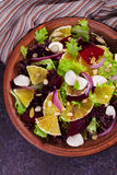 Mozzarella, Orange, Beetroot, Red Onion, Nuts and Seeds Salad. View from above, top studio shot Royalty Free Stock Photo