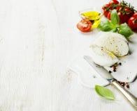 Mozzarella, organic cherry tomatoes and fresh basil Stock Images