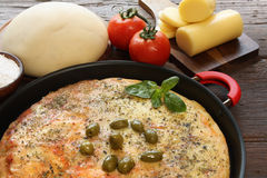 Mozzarella pizza. With some ingredients behind Stock Photo