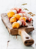 Mozzarella, prosciutto, melon canapes Stock Images