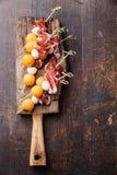 Mozzarella, prosciutto, melon canapes Royalty Free Stock Photography