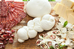 Mozzarella shaped braid on cutting board with salami and cheese Stock Photography