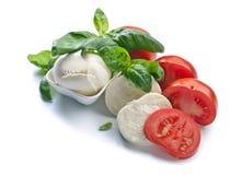 Mozzarella with tomato and basil isolated on white Royalty Free Stock Photos