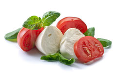 Mozzarella with tomato and basil isolated on white Stock Images