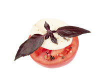 Mozzarella with tomato and basil leaves Stock Images