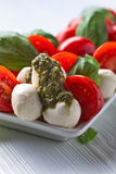Mozzarella with tomato , basil  and pesto sauce Stock Photography