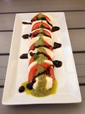 Mozzarella & tomato. Tomato mozzarella pesto & balsamic dressing Stock Image