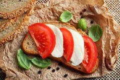 Mozzarella tomato sandwich. Healthy sandwich with mozzarella cheese and tomatoes Stock Image