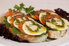 Mozzarella and Tomato Slices. Slices of tomato and mozzarella on sour dough Stock Photography