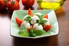 Mozzarella and tomatoes Stock Photos
