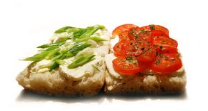 Mozzarella and tomatoes. Slices of mozzarella, tomatoes and spring onion over freshly baked ciabatta Royalty Free Stock Images