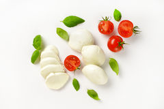 Mozzarella, Tomatoes And Basil Stock Photos