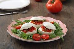 Mozzarella, tomatoes and arugola Stock Photography