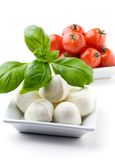 Mozzarella, tomatoes and basil Stock Image