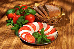 Mozzarella, tomatoes, basil, bread Royalty Free Stock Images