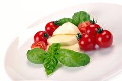 Mozzarella tomatoes basil Stock Photos