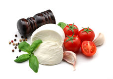 Mozzarella, tomatoes, basil and garlic. Typical italian food ingredients isolated over white Royalty Free Stock Photos