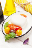 Mozzarella, tomatoes, basil and olive oil Stock Photography