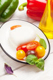 Mozzarella, tomatoes, basil and olive oil Royalty Free Stock Photography