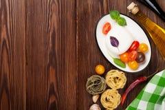 Mozzarella, tomatoes, basil and olive oil Stock Image