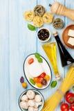 Mozzarella, tomatoes, basil and olive oil Royalty Free Stock Photos