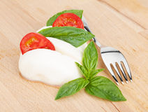 Mozzarella, tomatoes and basil Stock Photography