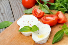 Mozzarella, tomatoes and basil Royalty Free Stock Photos