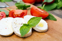 Mozzarella, tomatoes and basil Stock Photo