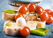 Mozzarella, tomatoes and bread. Italian Royalty Free Stock Photo