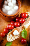 Mozzarella, tomatoes and bread. Italian Stock Images