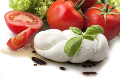 Mozzarella tomatoes and fresh salad Stock Photos