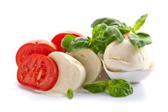 Mozzarella  with tomatoes and green basil isolated on white bac Royalty Free Stock Photo