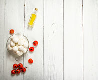 Mozzarella with tomatoes and olive oil. Stock Photos