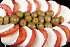 Mozzarella, tomatoes and olives stock image