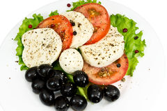 Mozzarella, tomatoes, olives and seasoning Royalty Free Stock Photos